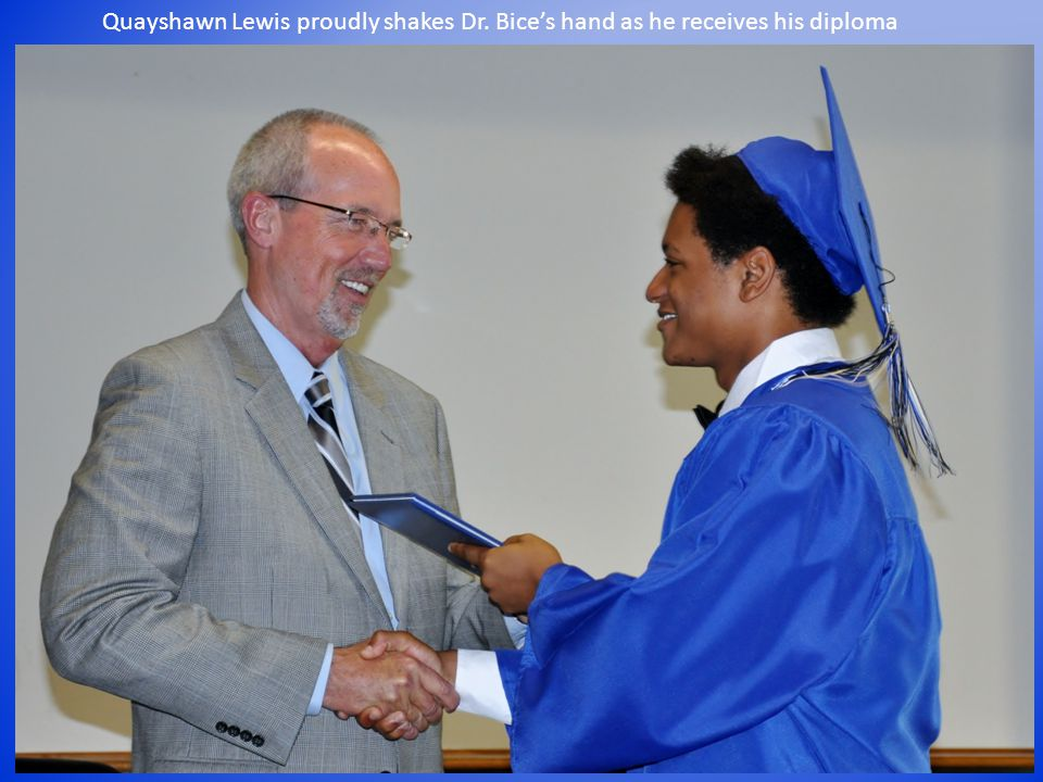 Quayshawn Lewis proudly shakes Dr. Bice's hand as he receives his diploma