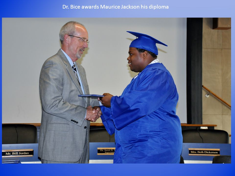 Dr. Bice awards Maurice Jackson his diploma