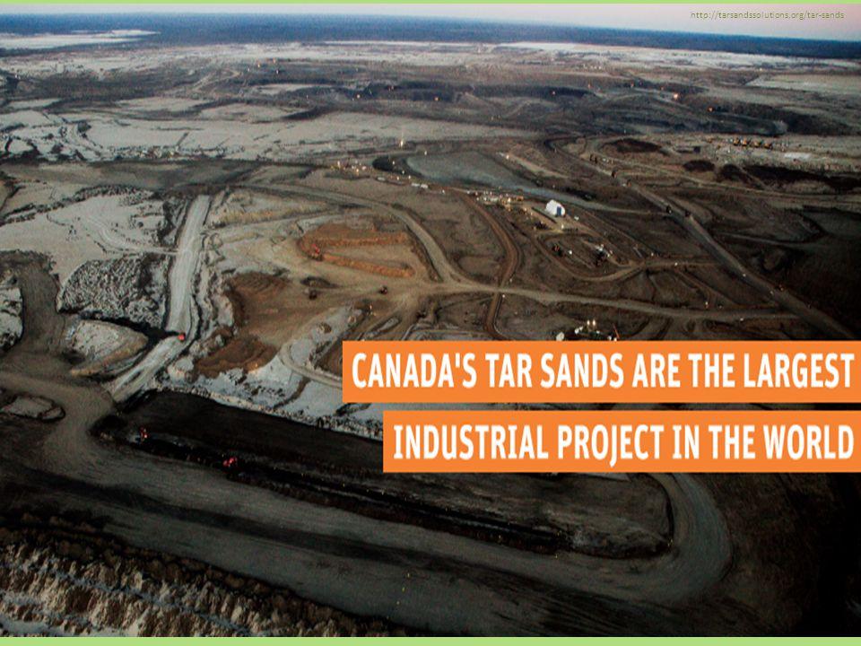 Mining trucks carry loads of oil-laden sand in Alberta, Canada.
