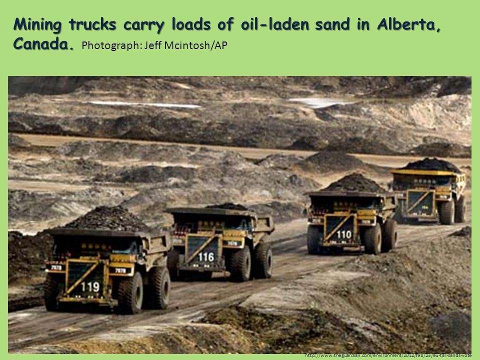 Mining trucks carry loads of oil-laden sand in Alberta, Canada. Mining trucks carry loads of oil-laden sand in Alberta, Canada. Photograph: Jeff Mcint