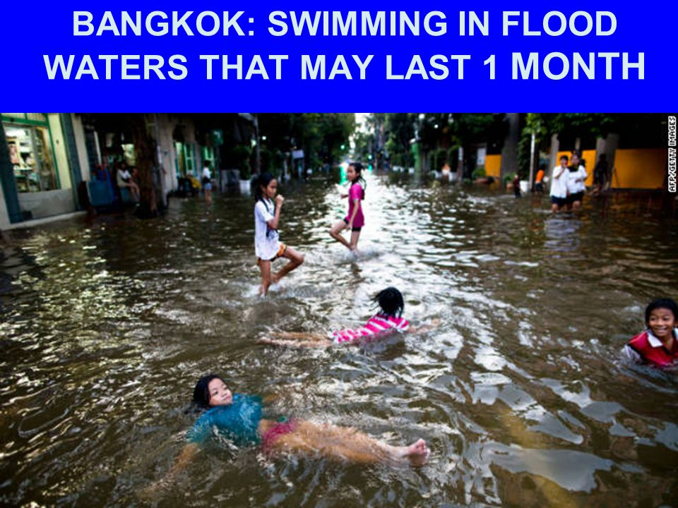 BANGKOK: SWIMMING IN FLOOD WATERS THAT MAY LAST 1 MONTH