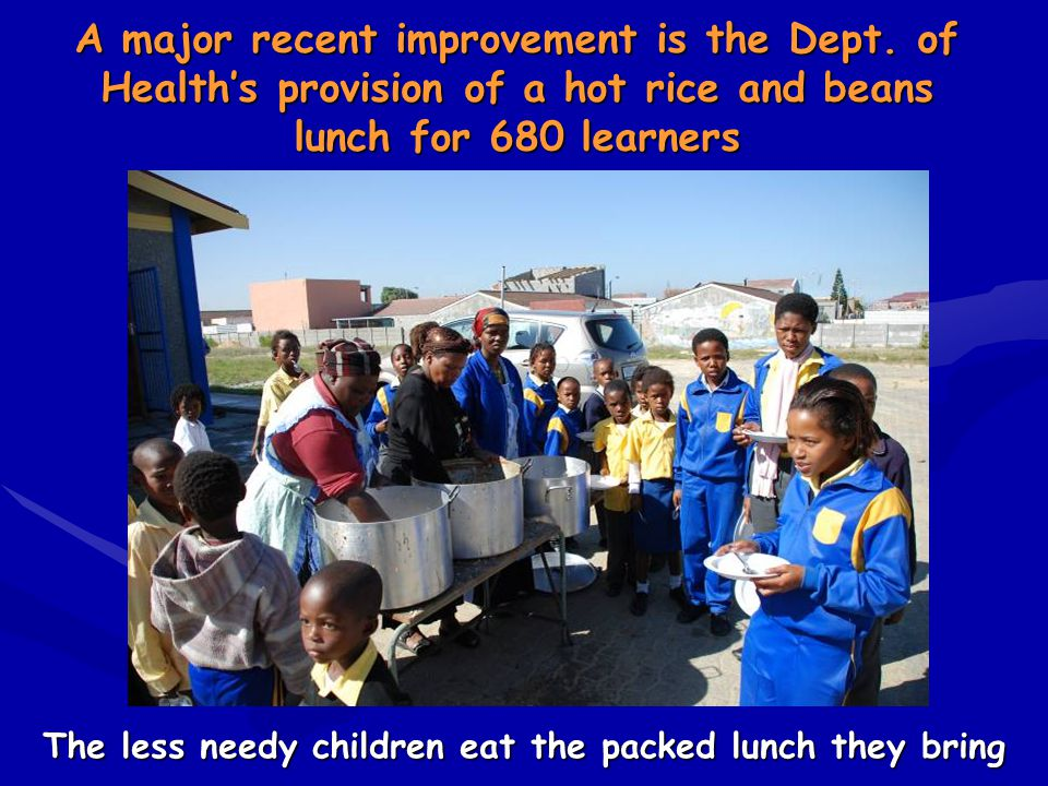 The less needy children eat the packed lunch they bring A major recent improvement is the Dept. of Health's provision of a hot rice and beans lunch fo