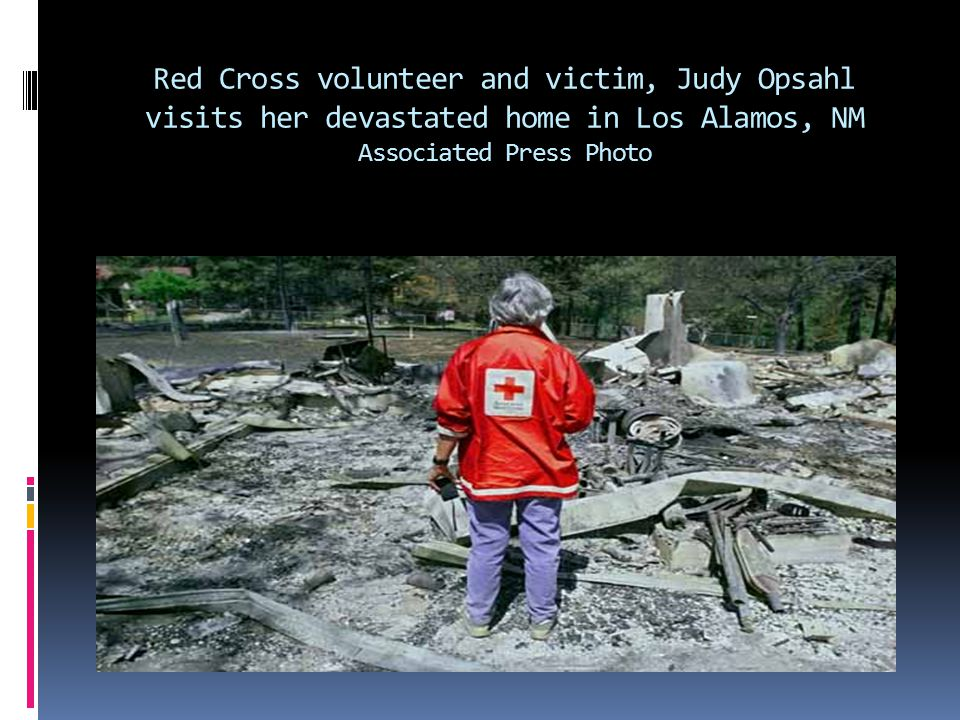 Red Cross volunteer and victim, Judy Opsahl visits her devastated home in Los Alamos, NM Associated Press Photo
