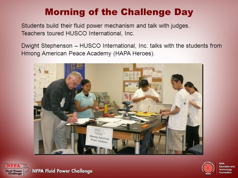 Morning of the Challenge Day Students build their fluid power mechanism and talk with judges.