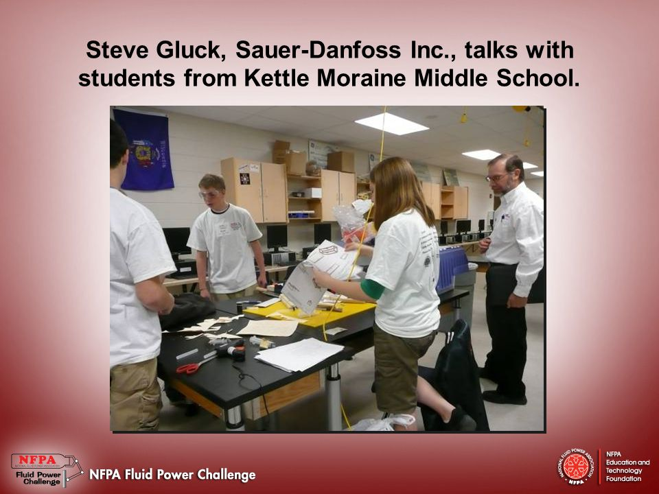 Steve Gluck, Sauer-Danfoss Inc., talks with students from Kettle Moraine Middle School.