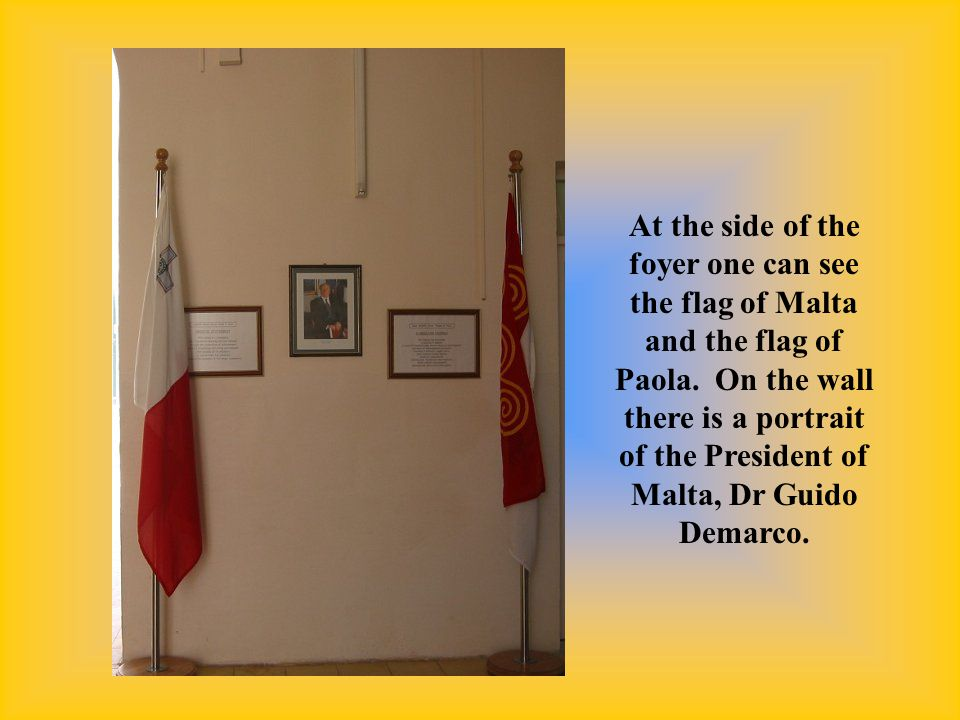 At the side of the foyer one can see the flag of Malta and the flag of Paola.