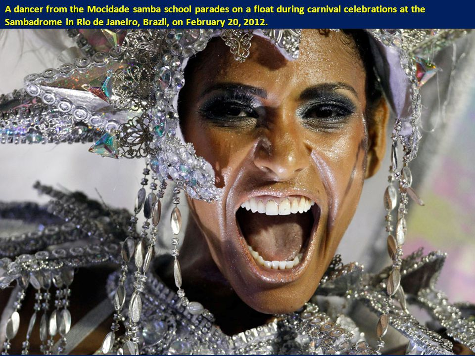 A dancer from the Mocidade samba school parades on a float during carnival celebrations at the Sambadrome in Rio de Janeiro, Brazil, on February 20, 2012.