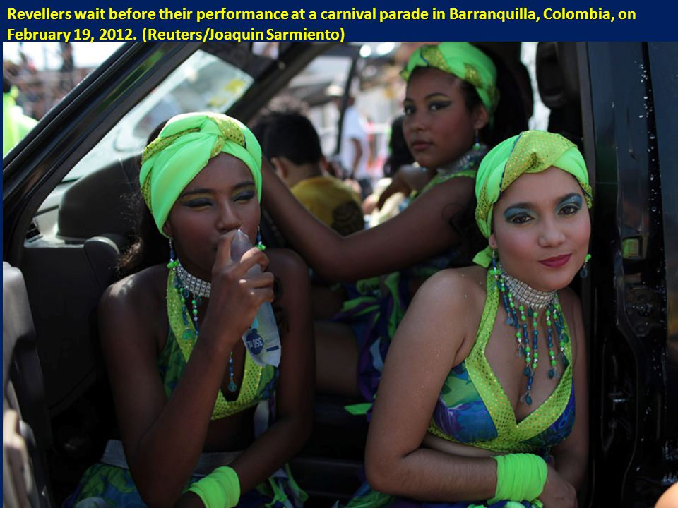 Revellers wait before their performance at a carnival parade in Barranquilla, Colombia, on February 19, 2012.