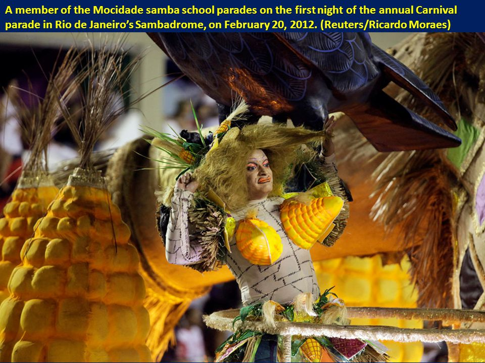 A member of the Mocidade samba school parades on the first night of the annual Carnival parade in Rio de Janeiro's Sambadrome, on February 20, 2012.