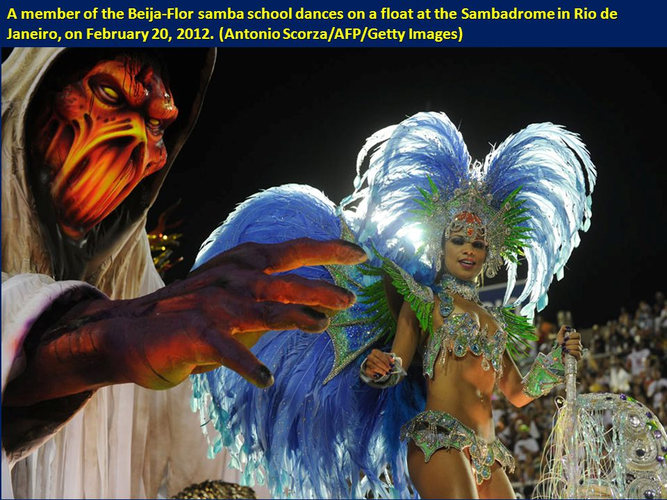 A member of the Beija-Flor samba school dances on a float at the Sambadrome in Rio de Janeiro, on February 20, 2012.