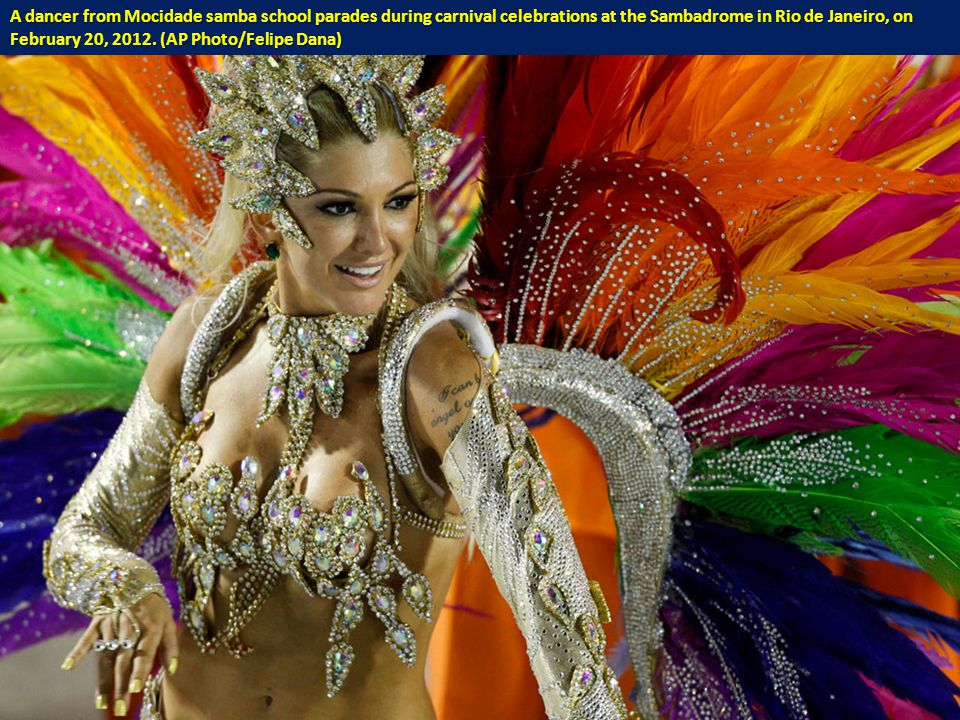A dancer from Mocidade samba school parades during carnival celebrations at the Sambadrome in Rio de Janeiro, on February 20, 2012.