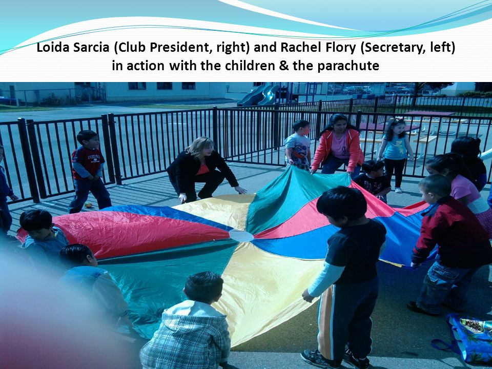 Loida Sarcia (Club President, right) and Rachel Flory (Secretary, left) in action with the children & the parachute