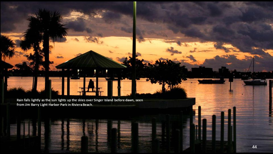 Fishermen try their luck on the Lake Worth Pier at sunrise. 43