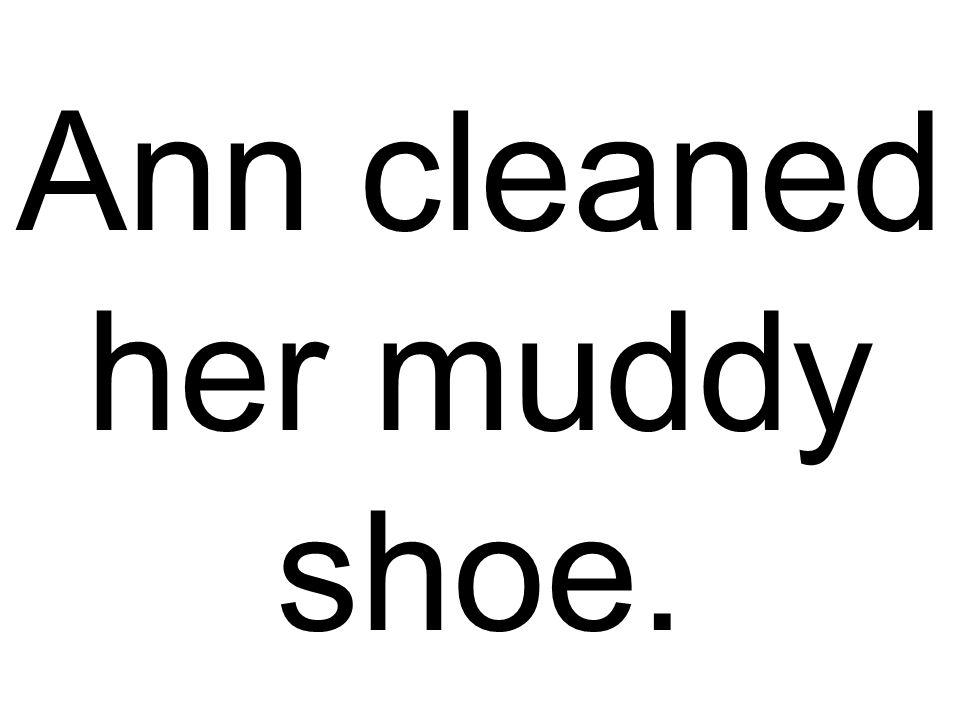Ann cleaned her muddy shoe.