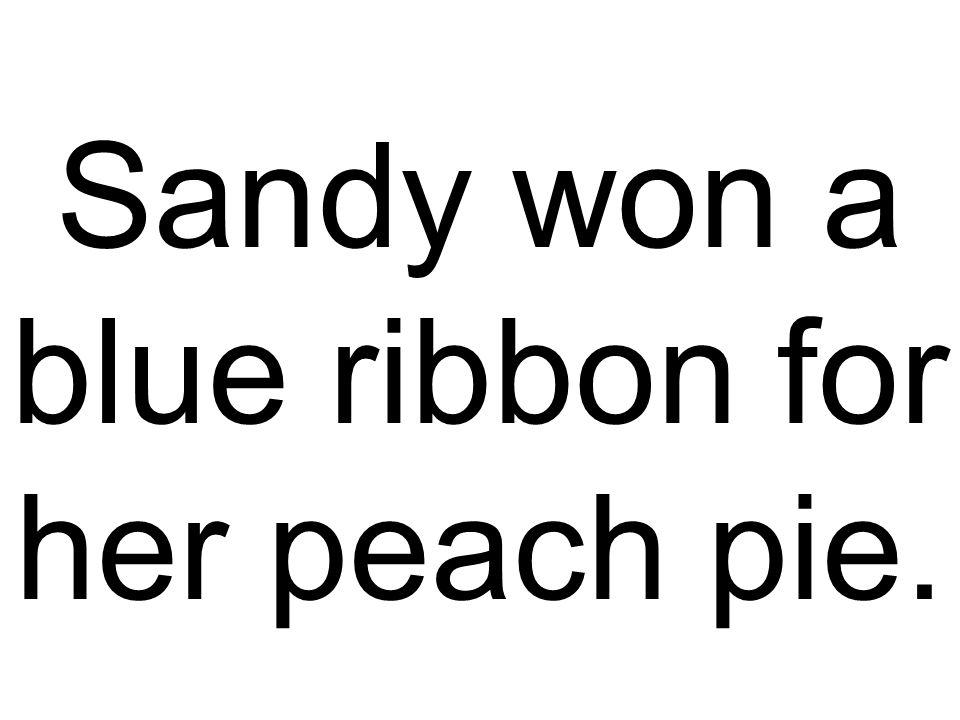 Sandy won a blue ribbon for her peach pie.