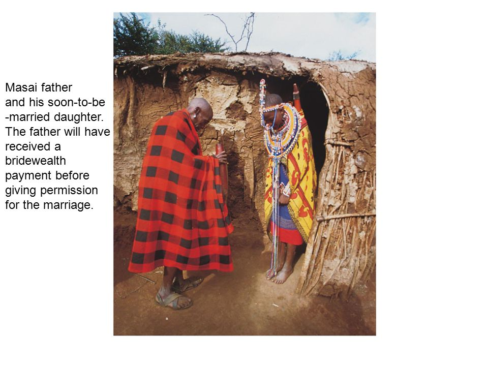 Masai father and his soon-to-be -married daughter. The father will have received a bridewealth payment before giving permission for the marriage.