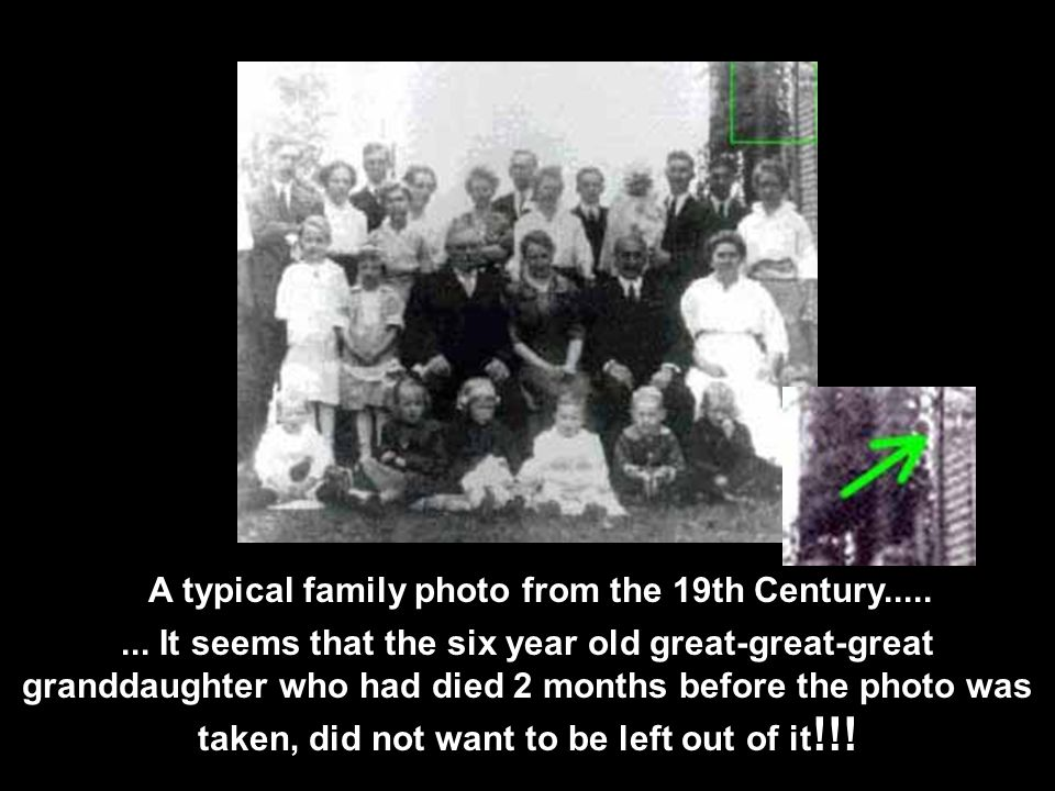 It looks like an ordinary family shot... But who is the person looking on in the background?