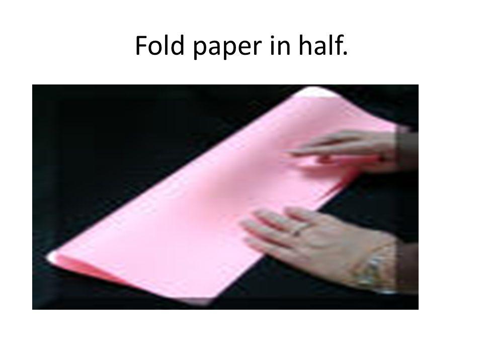 Fold paper in half.