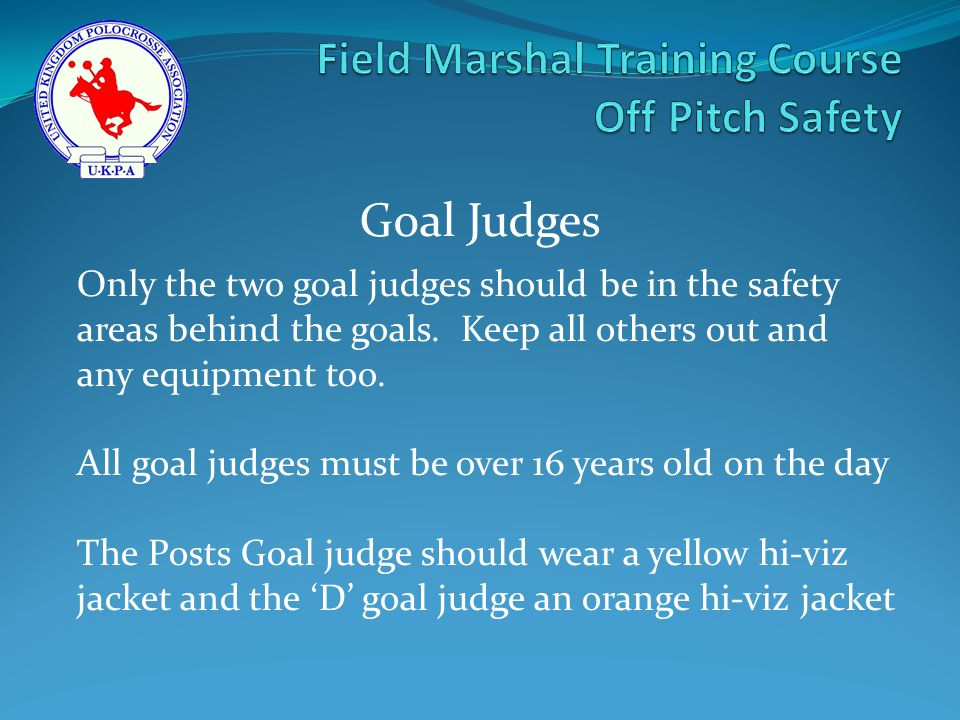 Only the two goal judges should be in the safety areas behind the goals.