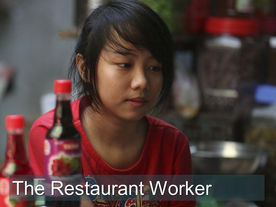 I like working here said Tu as she served food to a customer.