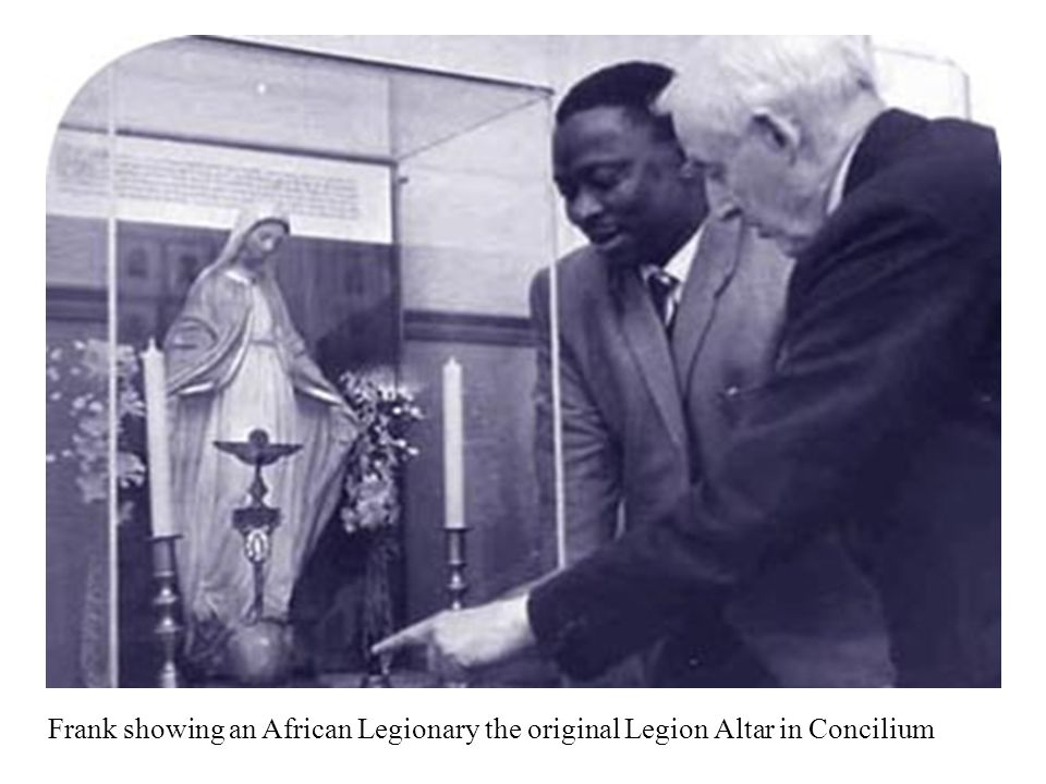 Frank showing an African Legionary the original Legion Altar in Concilium