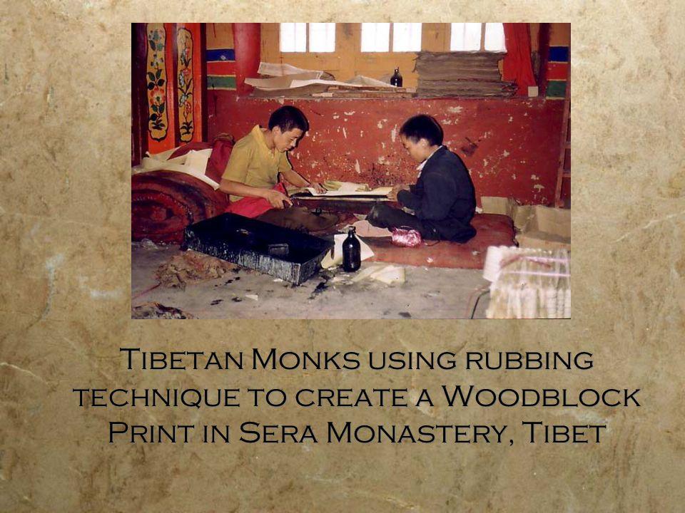 Tibetan Monks using rubbing technique to create a Woodblock Print in Sera Monastery, Tibet