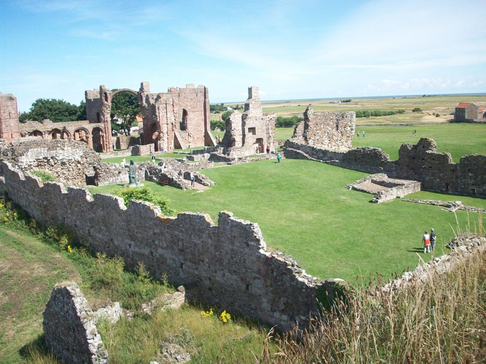 Lindisfarne ( Holy Island ): ruins of the Norman era monastery on the site of the Anglo-Saxon monastery where the Lindisfarne Gospels were produced.