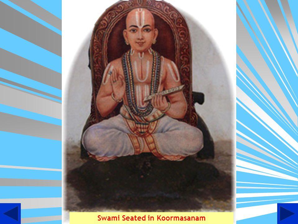 Swami Desikan at Thooppul adorning Lord Devanathan in his Vakshatsthalam
