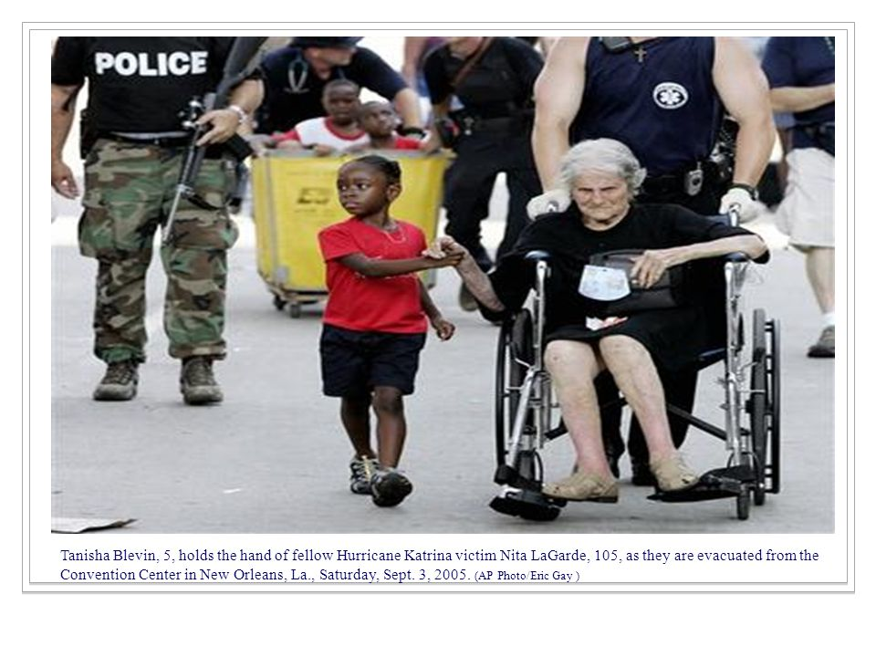 Tanisha Blevin, 5, holds the hand of fellow Hurricane Katrina victim Nita LaGarde, 105, as they are evacuated from the Convention Center in New Orleans, La., Saturday, Sept.