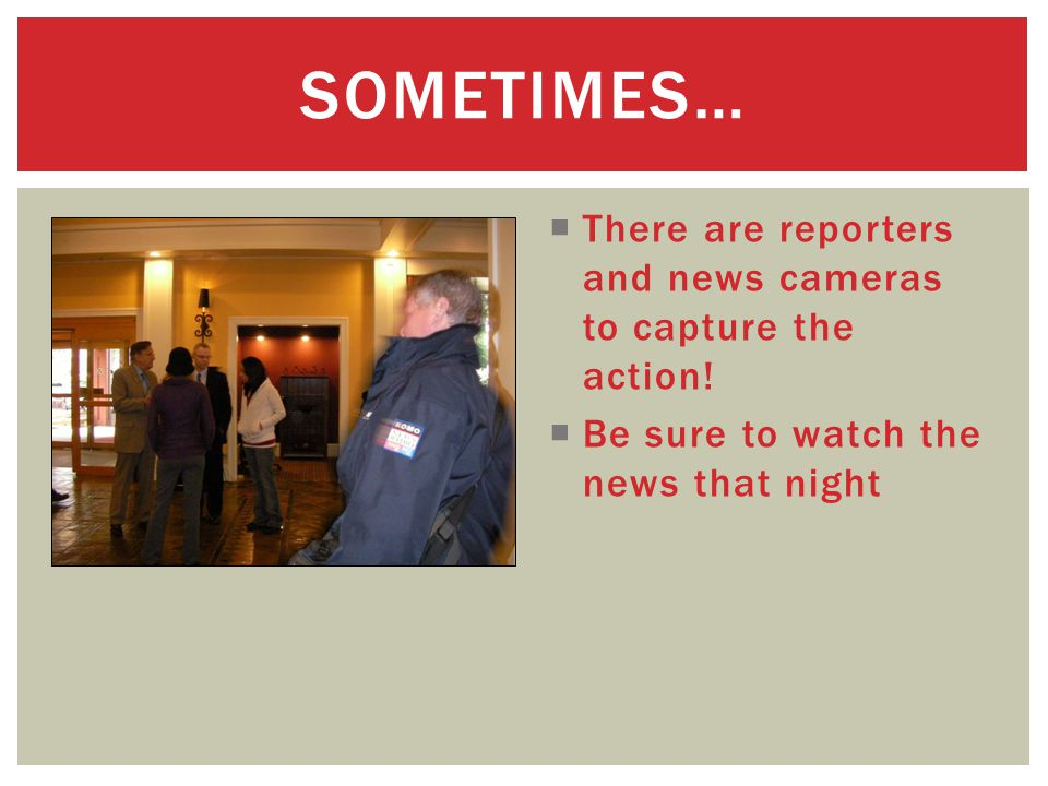  There are reporters and news cameras to capture the action.