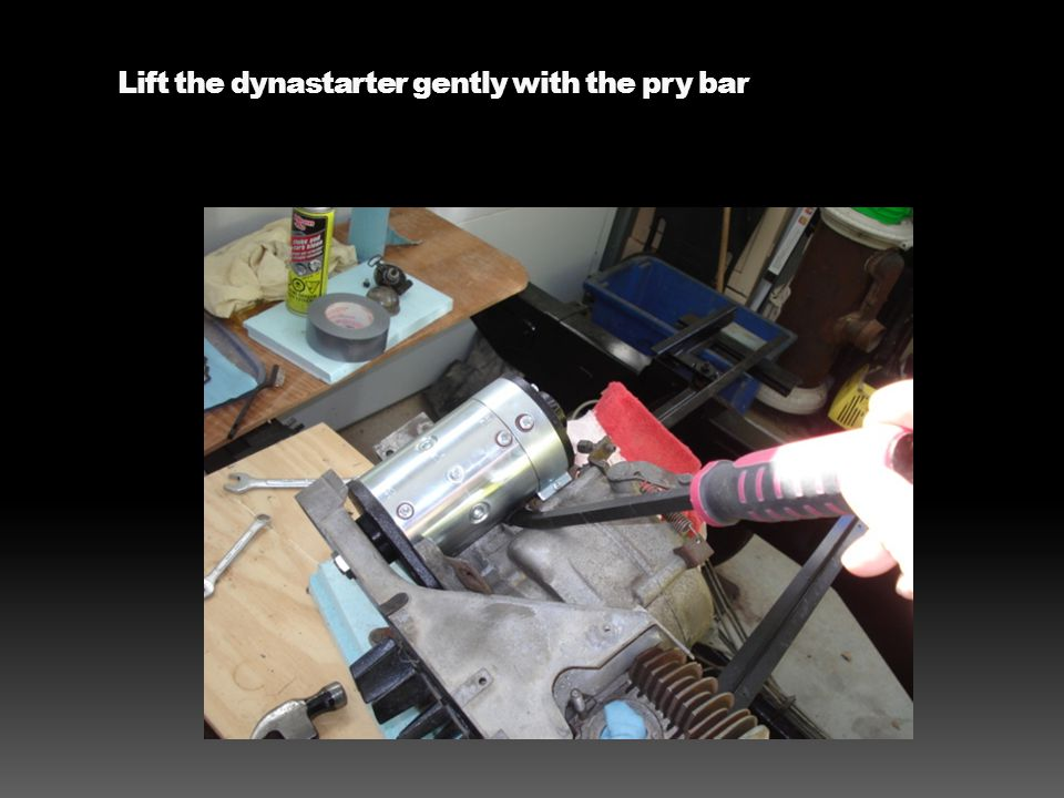 Lift the dynastarter gently with the pry bar