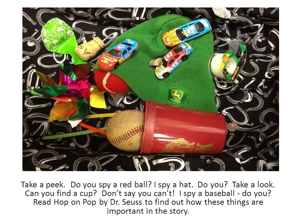 Take a peek. Do you spy a red ball? I spy a hat. Do you? Take a look. Can you find a cup? Don't say you can't! I spy a baseball - do you? Read Hop on