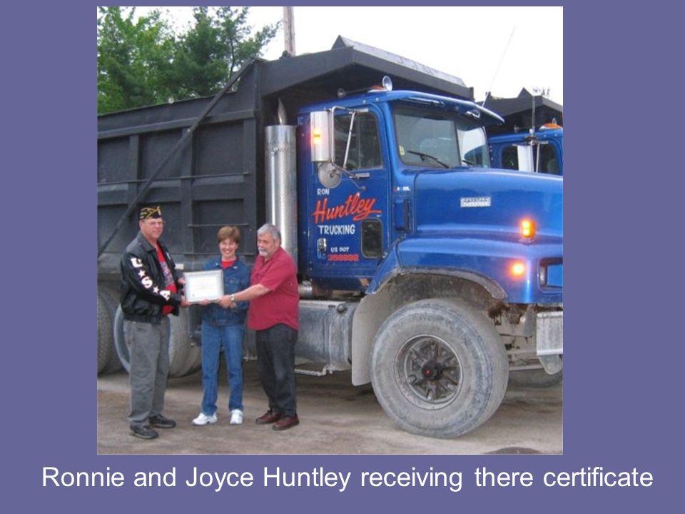 Gary Hamel giving Dave Gordon a certificate of appreciation
