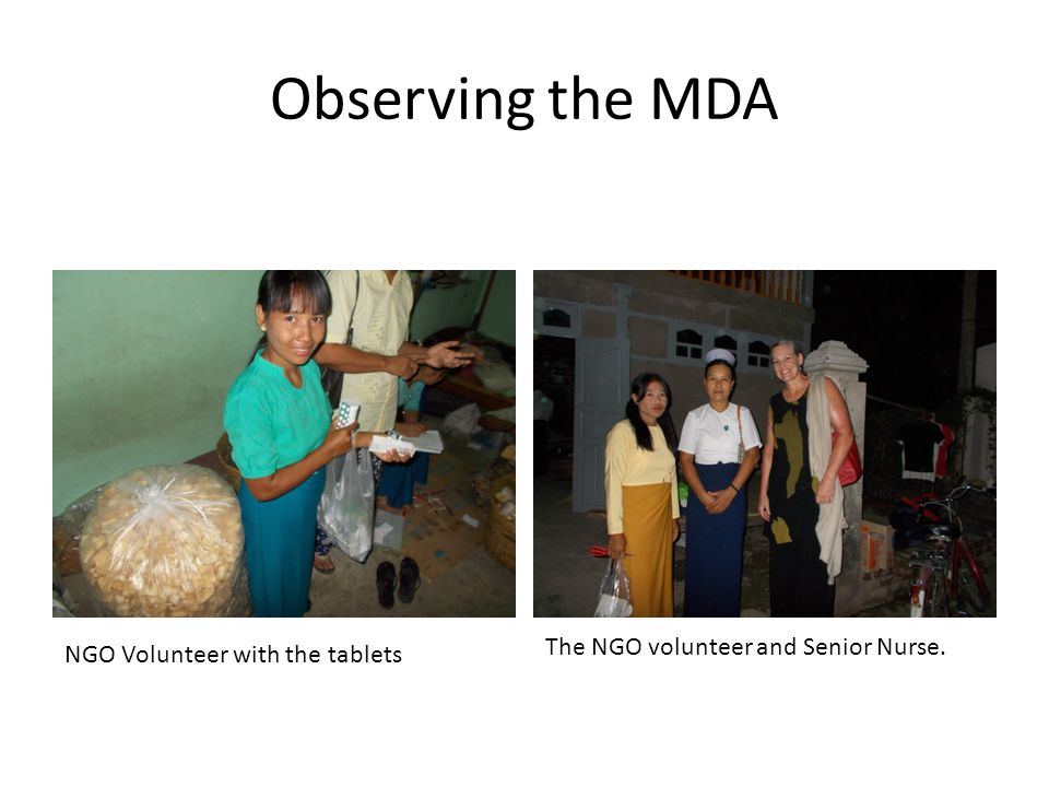 Observing the MDA NGO Volunteer with the tablets The NGO volunteer and Senior Nurse.