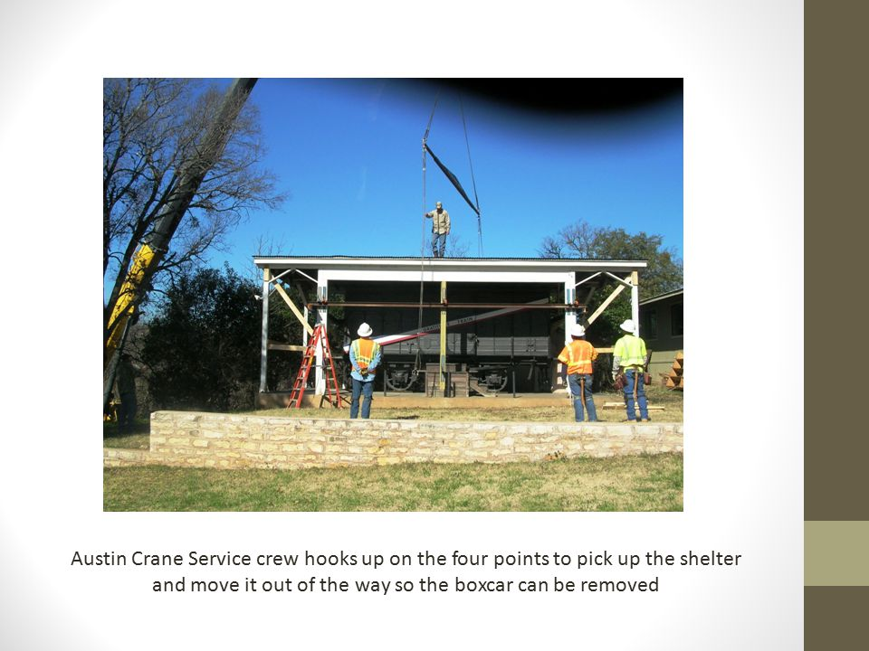 Austin Crane Service crew hooks up on the four points to pick up the shelter and move it out of the way so the boxcar can be removed