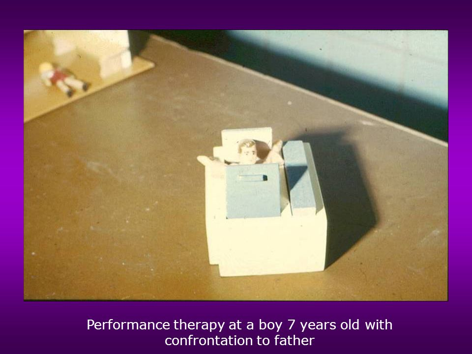 Performance therapy at a boy 7 years old with confrontation to father
