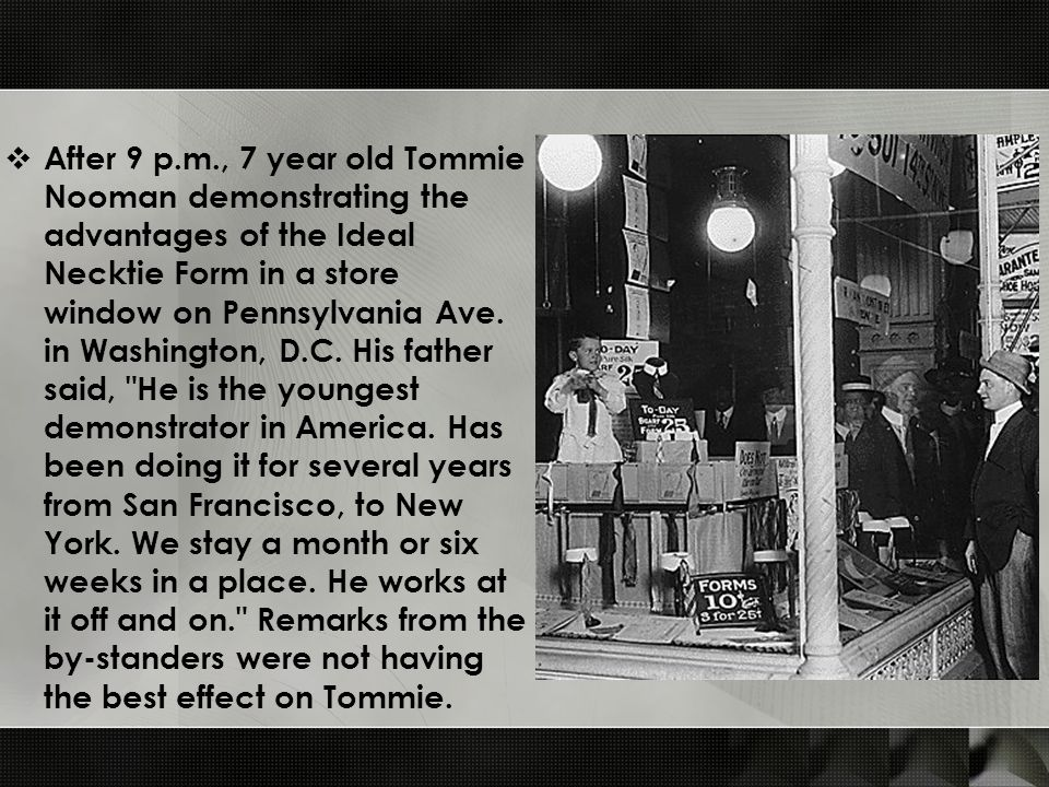  After 9 p.m., 7 year old Tommie Nooman demonstrating the advantages of the Ideal Necktie Form in a store window on Pennsylvania Ave.