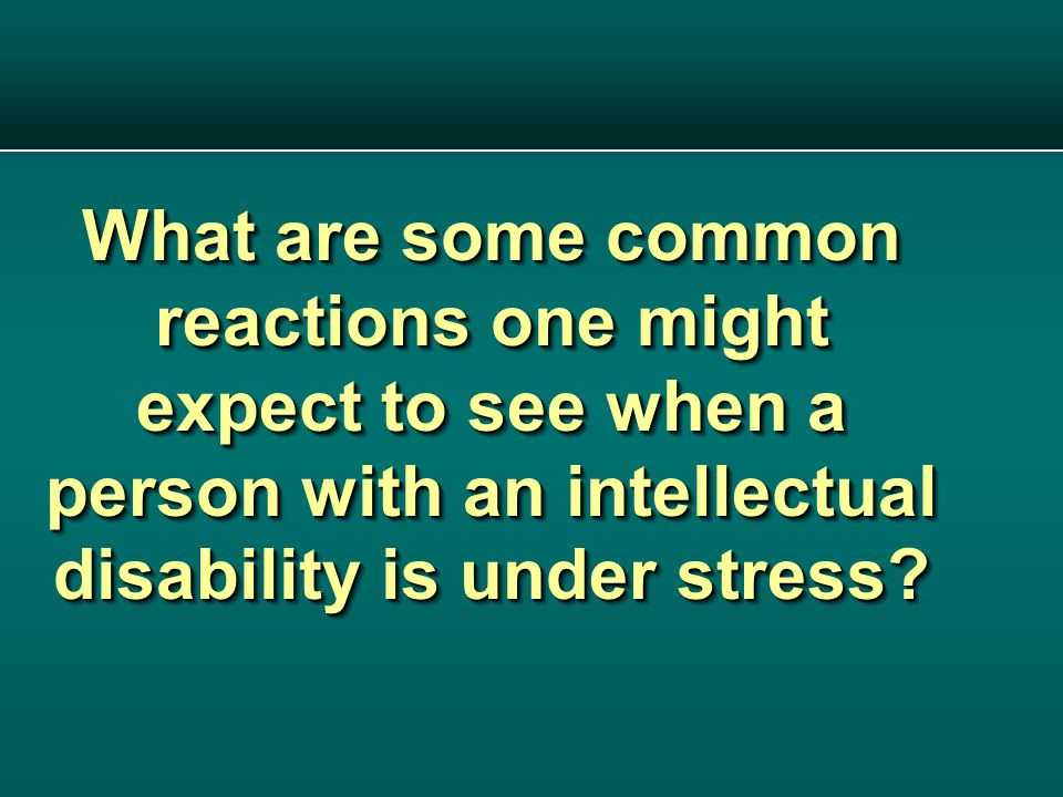 What are some common reactions one might expect to see when a person with an intellectual disability is under stress?