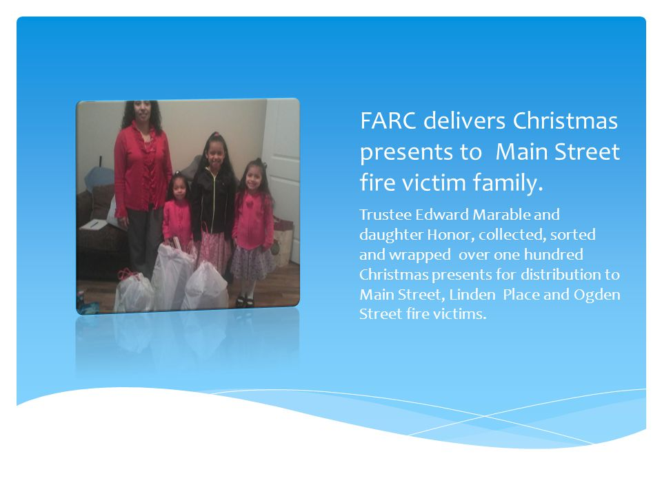 FARC volunteers delivers Christmas to 3 fire victim families in West Orange Honor and Judah Marable join Rose Simms in bringing Christmas cheer to Roger (grey sweat shirt) and the three other families.