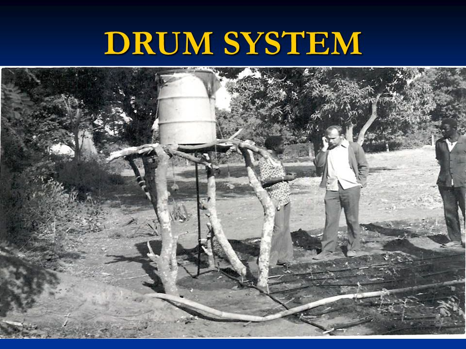 A 50 Gallon Drum was Mounted 6 Feet Above the A 50 Gallon Drum was Mounted 6 Feet Above the Soil and Drip Lines were Soil and Drip Lines were Connected for Each Row Connected for Each Row