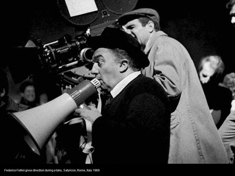 Giuseppe Rotunno with Federico Fellini who pretends to sleep on the set of Fellini's Satyricon,Rome, Italy 1969
