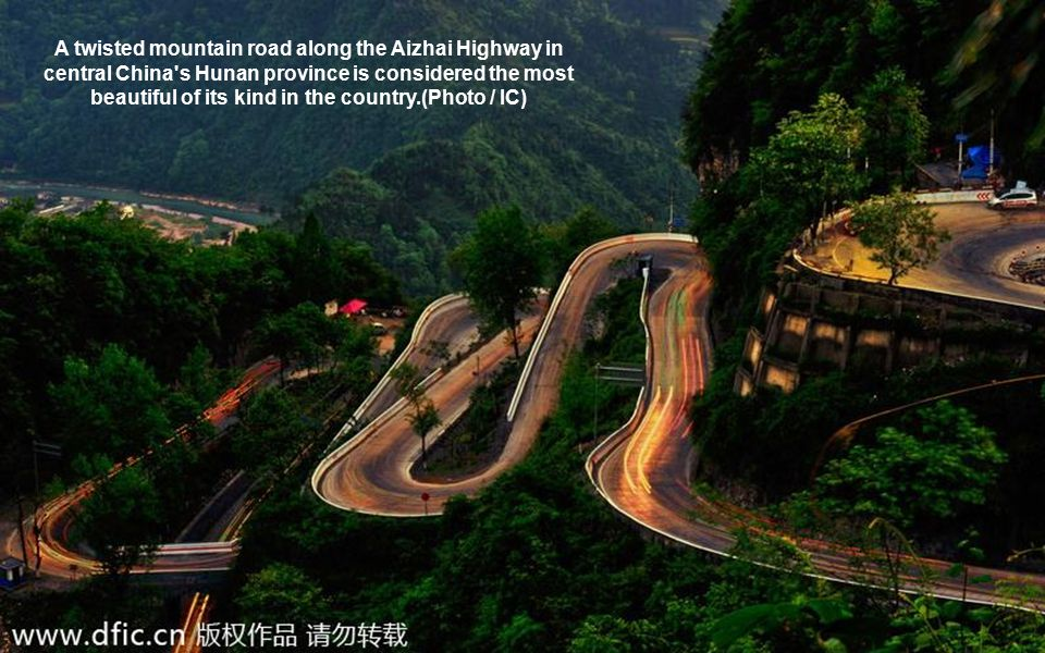 A twisted mountain road along the Aizhai Highway in central China's Hunan province is considered the most beautiful of its kind in the country.(Photo