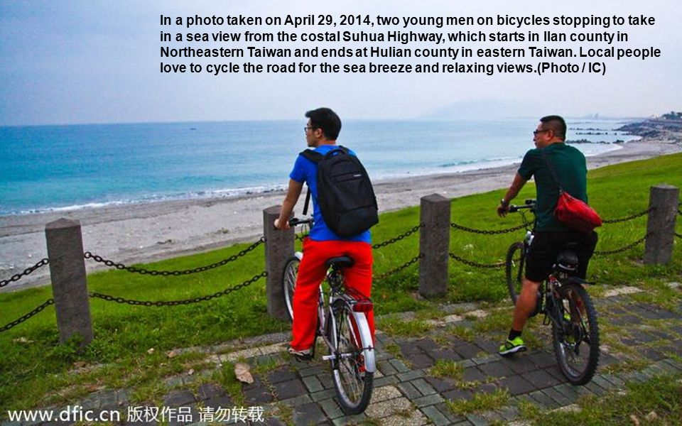 In a photo taken on April 29, 2014, two young men on bicycles stopping to take in a sea view from the costal Suhua Highway, which starts in Ilan count