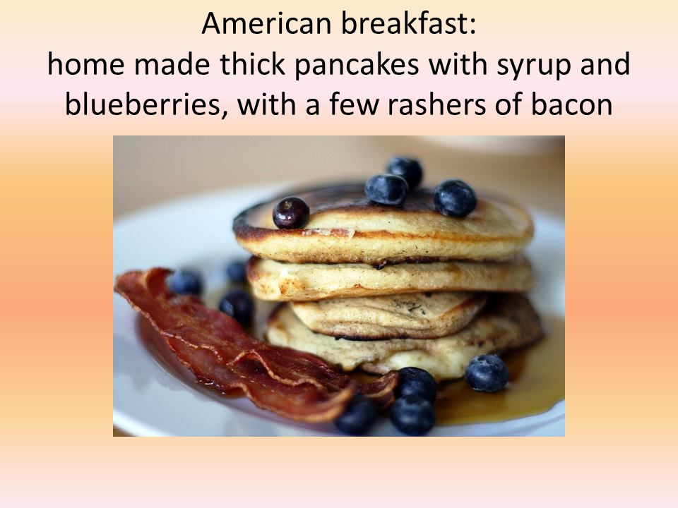 American breakfast: home made thick pancakes with syrup and blueberries, with a few rashers of bacon