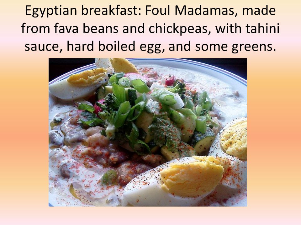 Egyptian breakfast: Foul Madamas, made from fava beans and chickpeas, with tahini sauce, hard boiled egg, and some greens.