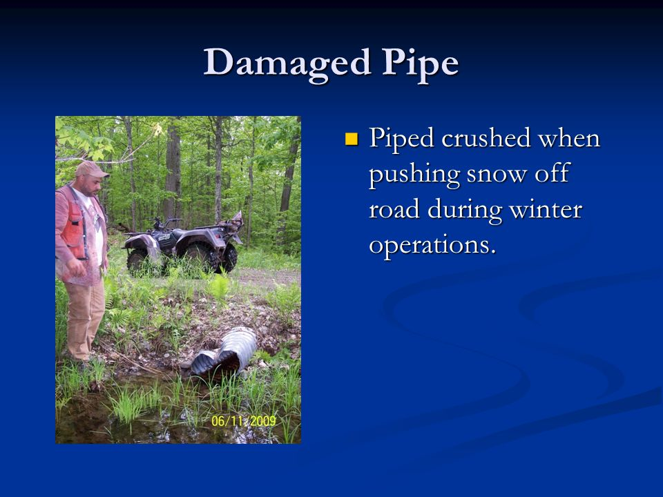 Damaged Pipe Piped crushed when pushing snow off road during winter operations.