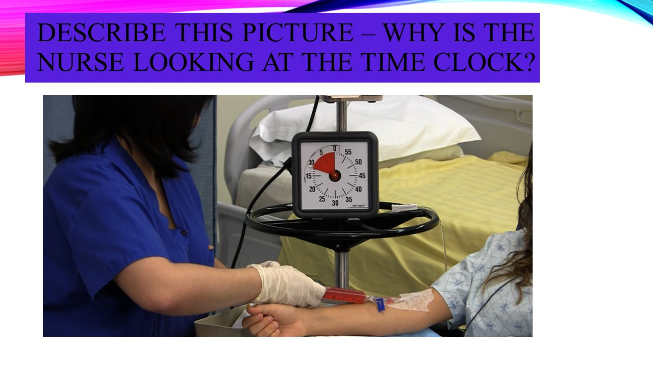 DESCRIBE THIS PICTURE – WHY IS THE NURSE LOOKING AT THE TIME CLOCK?