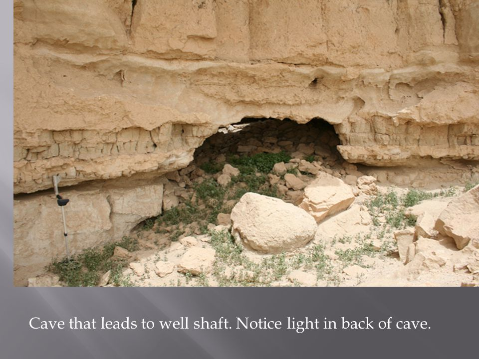 Cave that leads to well shaft. Notice light in back of cave.