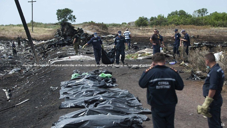In the heat: Emergency workers were pictured today at the crash site still struggling to gather together the last bodies of victims 15