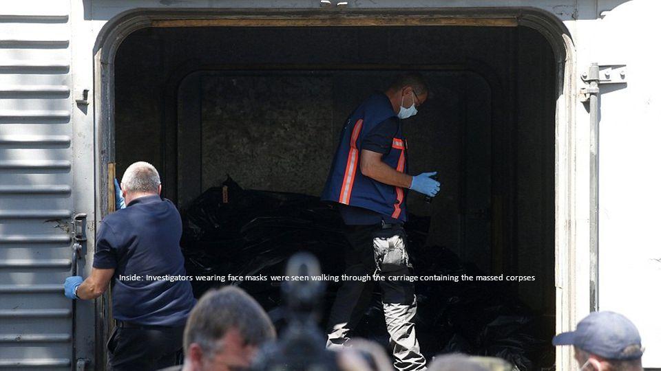 Tributes: Ukrainian President Petro Poroshenko left flowers outside the Dutch embassy in Kiev 24